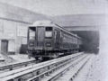 An electric train emerging from the Mersey Railway Tunnel.png