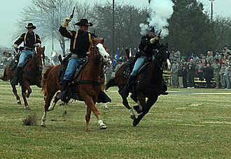 15th Sustainment Brigade - Soldiers of the 1st Cavalry Division perform a mock cavalry charge during the 15th Sustainment Brigade's change of command ceremony, alluding to the brigade's history as a cavalry unit.