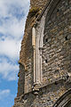 Athassel Priory St. Edmund Choir West Portal Arched Recess Left Pier 2012 09 05.jpg