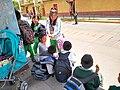 Ayacucho Peru- schoolkids waiting for bus.jpg