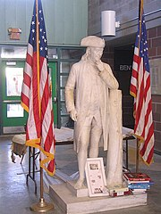 A marble statue of Benjamin Franklin stands in the atrium of Benjamin Franklin High School in New Orleans, Louisiana