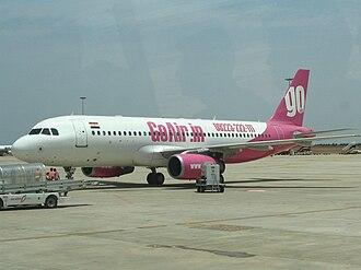 Wadia Group - A GoAir aircraft at Bangalore International Airport, with pink colors.