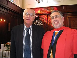 Doctor of Philosophy - A South African PhD graduate (on right, wearing ceremonial gown)