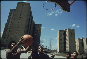 Poverty in the United States - Youth play in Chicago's Stateway Gardens high-rise housing project in 1973.