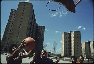 Great Migration (African American) - African-American youths play basketball in Chicago's Stateway Gardens high-rise housing project in 1973.