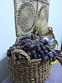 Basket of grapes and harvested barley.jpg