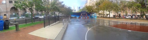 Basketball court with puddles after a rainstorm, 2014 09 21