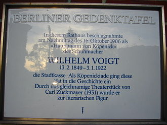 Wilhelm Voigt - A commemorative memorial plate for Wilhelm Voigt and the Captain of Köpenick at Köpenick city hall. The text explains the happenings in short form, including the exact date, and the later following fame of the case through the play of Carl Zuckmayer.