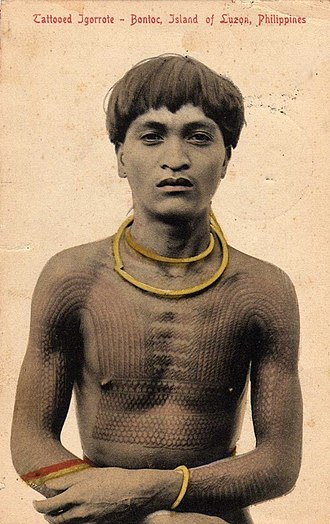 History of tattooing - A 1908 photo of a Bontoc warrior bearing a head hunter's chaklag tattoo