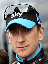"Bradley Wiggins wearing a black cap with the word ""SKY"" written on it"