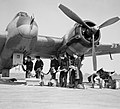 Bristol Beaufighter Mk VIF of No. 96 Squadron RAF being re-armed at Honily, Warwickshire, 23 March 1943. CE22.jpg