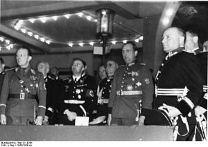 Arturo Bocchini - Germany's Reichsfuhrer SS Heinrich Himmler (second person to the right) standing next to Bocchini (third person to the right and behind Himmler) during a visit to Berlin.