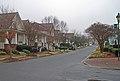 Bungalows facing a park Birkdale village (5488719295).jpg