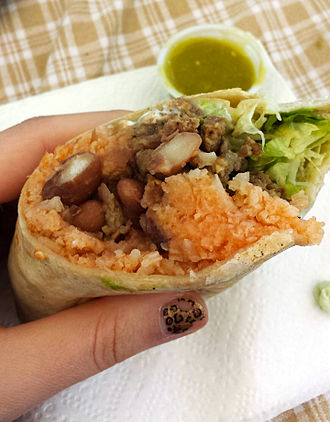 Burrito - Mission style burrito, showing rice, meat, beans, lettuce