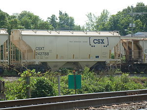 "Covered hopper - A CSX Hopper being switched in Knoxville, Tennessee shows off the new ""How tomorrow moves"" slogan (Two-bay Centerflow shown)"