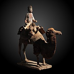 statue of a camel and camel driver