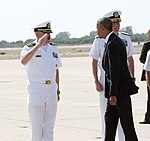 Capt. Michael MacNicholl, Naval Station Rota's commanding officer, renders honors to President Barack Obama as he arrived at Naval Station Rota (28225346685).jpg