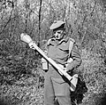 Captain W Guest-Gordons, Intelligence Officer with No. 2 Infantry Brigade, examines a German Panzerfaust anti-tank weapon, Anzio, 27 February 1944. NA12272.jpg