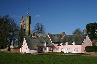Cavendish, Suffolk - The Pink Cottages and St Mary's Church, from the village green