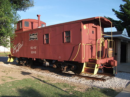 Frisco caboose at Centennial Park, Rogers Historical District downtown. The caboose is emblematic of Rogers' railroad history. Centennial Caboose in Rogers Arkansas.JPG