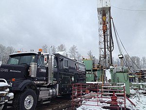 Wireline (cabling) - Wireline truck rigged up to a drilling rig in Canada
