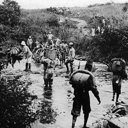Force Publique soldiers in the Belgian Congo in 1918. At its peak, the Force Publique had around 19,000 African soldiers, led by 420 white officers. Congo belge campagne 1918.jpg