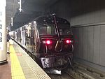 "Cruise train ""Seven Stars in Kyushu"" stopping at Hakata Station.jpg"