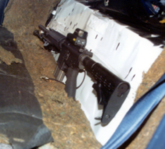 D.C. sniper attacks - The stolen Bushmaster XM-15 rifle used by Muhammad and Malvo during their attacks. It was fitted with an EOTech holographic weapon sight, a bipod, and a 20-round STANAG magazine at the time of their capture.