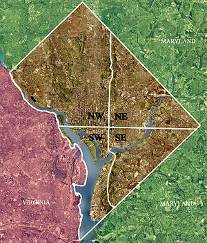 Northwest, Washington, D.C. - Color-enhanced USGS satellite image of Washington, D.C., taken April 26, 2002.  The crosshairs in the image mark the quadrant divisions of Washington, with the U.S. Capitol at the center of the dividing lines.  To the west of the Capitol extends the National Mall, visible as a slight green band in the image. The Northwest quadrant is the largest, located north of the Mall and west of North Capitol Street.