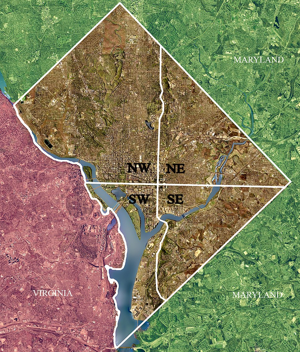 """Color-enhanced USGS satellite image of Washington, D.C., taken April 26, 2002. The """"crosshairs"""" in the image mark the quadrant divisions of Washington, with the U.S. Capitol at the center of the dividing lines. To the west of the Capitol extends the National Mall, visible as a slight green band in the image. The Northwest quadrant is the largest, located north of the Mall and west of North Capitol Street."""