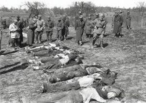 Italian war crimes - Italian troops walk among the bodies of Greek civilians executed during the Domenikon massacre.