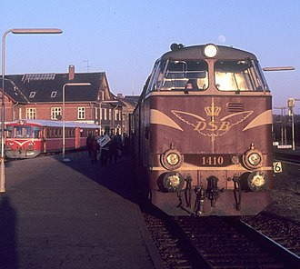 Hjørring station - DSB train on the Vendsyssel Line calling at Hjørring in 1975. To the left a local train ready to depart for Hirtshals.