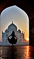 Dawn at taj. Was fortunate to capture this girl posing for her friend having the beauty of Taj Mahal in the background.jpg