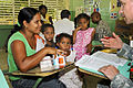 Defense.gov News Photo 110604-A-CL600-103 - U.S. Army Maj. Dr. Matthew Johnson talks to a Dominican mother about medication doses during a medical readiness training exercise in Esperanza.jpg