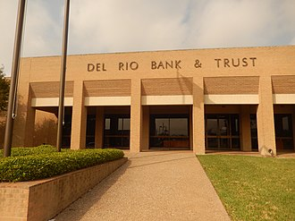Val Verde County, Texas - Del Rio Bank and Trust Company was organized in 1910. The bank is hence a year older than the Del Rio city government and has served Val Verde County for more than a century. The photo is the facility at 1200 Veterans Blvd.; another location is 22411 N Bedell Ave.