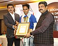 Dharmendra Pradhan and the Minister of State for Youth Affairs and Sports (IC) and Information & Broadcasting, Col. Rajyavardhan Singh Rathore felicitating the journalists, at the annual function of Odia daily Nirbhaya.jpg