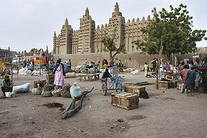 Great Mosque of Djenné - The current mosque, photographed in 2003, behind the town's market