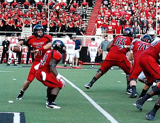 2011 Texas Tech Red Raiders football team - Quarterback Seth Doege drops back to pass during Texas Tech's season-opening win over Texas State.
