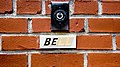 Doorbell button on brick with label.jpg