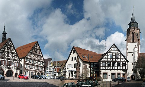 The Market Place At Dornstetten Showing Half Timbered Buildings With The Medieval Church Of St