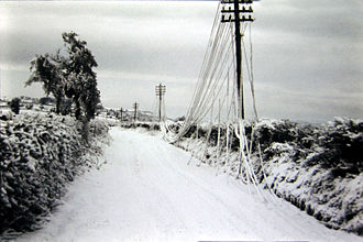 Winter of 1962–63 in the United Kingdom -  The weight of snow and ice stretched the copper telephone wires until they reached the ground. East Dundry Lane, Somerset, January 1963