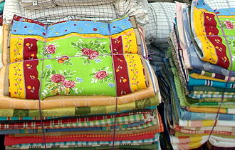 Erode - Fabrics and rugs made in Erode are famous throughout India and are exported