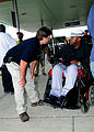FEMA - 38060 - FEMA worker helps a resident at train station in New Orleans.jpg