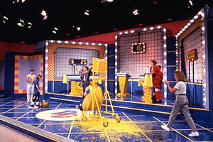 "Double Dare (Nickelodeon game show) - A contestant, dressed in a ""hot dog bun"", is covered in ""mustard"" and has completed a 1990 Family Double Dare physical challenge."