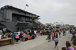Family and friends of U.S. Sailors aboard the aircraft carrier USS Harry S. Truman (CVN 75) watch as the ship departs Naval Station Norfolk, Va., July 22, 2013 120722-N-BD629-021.jpg