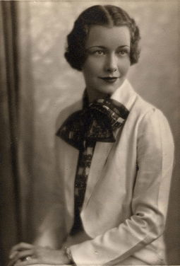A smart young woman in a lightweight jacket and printed silk blouse. American, 1935. Fashionable woman in 1935.jpg