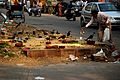 Feeding birds - busy street in Delhi, India-14Nov2010.jpg