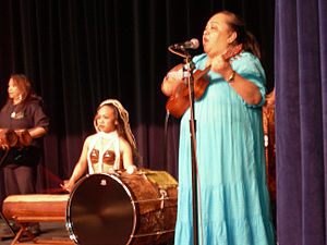 e68f52cbc96c5 Hawaiian singer wearing a Muumuu and playing the ukulele