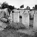 Field Marshal Montgomery reads the inscription on a grave at the Canadian First World War memorial at Vimy Ridge, 8 September 1944. BU763.jpg