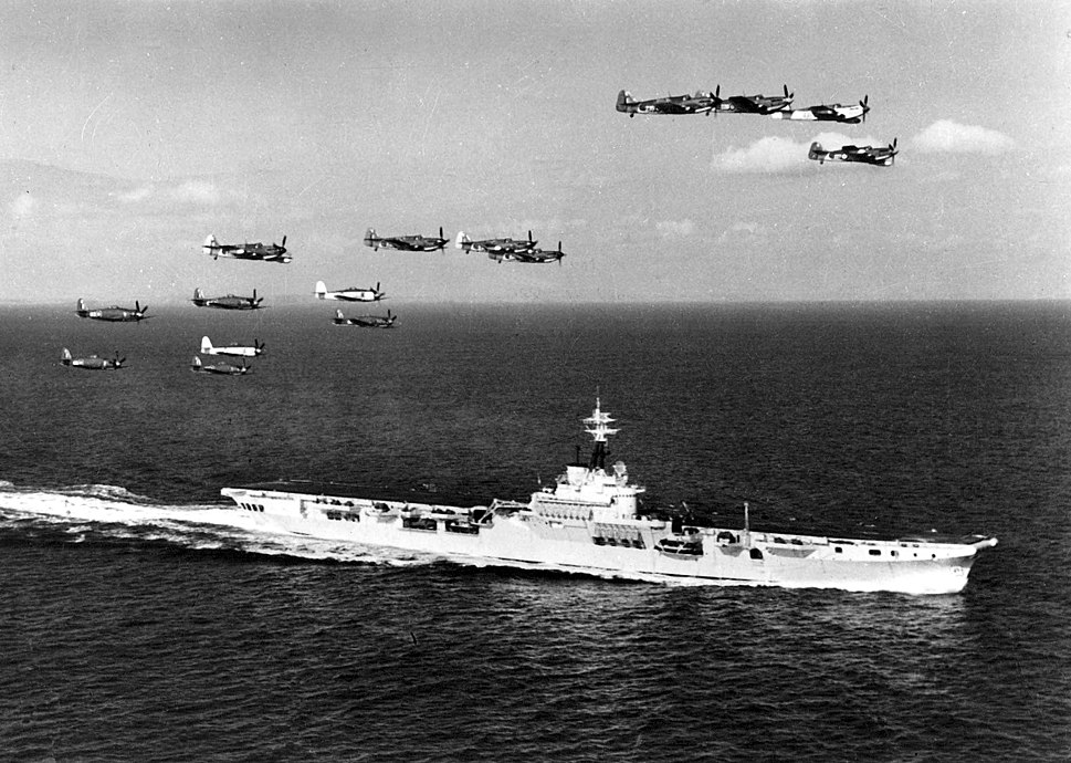 Fireflies and Sea Furies over HMAS Sydney (R17) c1949